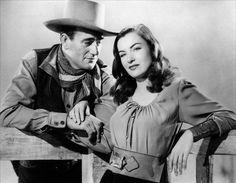 """Ella Raines & John Wayne in """"Tall in the Saddle"""" (1944)"""