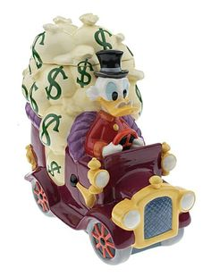 """DJ2615 DISNEY UNCLE SCROOGE MCDUCK LE 250 Cookie Jar  Old Moneybags himself, the famously wealthy Uncle Scrooge McDuck, manages his own transfer of funds on this distinctive cookie jar, a Disney Auctions exclusive in a limited edition of 250 pieces.   SIZE: approx. 6.5"""" x 11.25"""" x 13""""   MATERIALS: fine ceramic"""