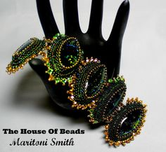 Bead embroidered Dichroic Glass bracelet by TheHouseofBeads, $287.00
