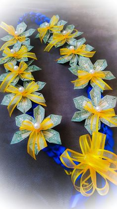 With real pearls from a strand of broken ones awesome! Graduation Crafts, Graduation Gifts For Friends, Graduation Leis, Graduation Cap Decoration, Money Rose, Money Lei, Money Origami, Money Creation, Money Flowers