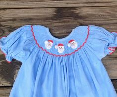Smocked Christmas Dress Santa Face Bishop Dress on by SmockStar