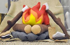 Felt Campfire, complete with logs, flames, rocks, marshmallows, roasting sticks, and s'more fixings