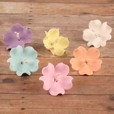 Mixed Colors of Gumpaste Fruit Blossoms cake toppers and cupcake toppers perfect for cake decorating rolled fondant cakes. | www.CaljavaOnline.com #caljava #sugarflower #cupcaketopper