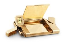 "Jaeger-LeCoultre for Dunhill - Gold Pocket Compendium Jaeger-LeCoultre, ""Vanity"", movement No. 548705, retailed by Alfred Dunhill, the case by Matteo Cellini ""Bando"", with London hallmarks for 1949-1950. Fine and very rare, 9K gold pocket compendium with cigarette case, lighter, telescopic pencil, penknife, concealed ivory writing tablet, drill, stamp container, ruler and watch."