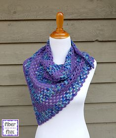 The Larkspur Shawlette is a pretty little accessory that is perfect for warmer weather when you just need a little something extra. Using alternating rows of variegated and solid colors makes a fun piece that is interesting to work up. A simple granny triangle construction with a pretty and simple scallop makes this piece fun for beginners and seasoned crocheters alike!