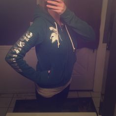 Pink Victoria Secret bling michigan  state hoodie. This hoodie is green. Some of the lettering is faded. And one jewel fell off on the M on the back side. See in pictures. PINK Victoria's Secret Tops Sweatshirts & Hoodies
