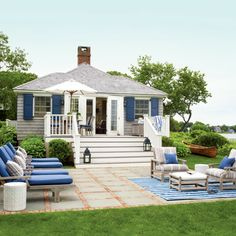 This small Hamptons hideaway sits on a marsh grass-bordered creek and features two bedrooms and two bathrooms.