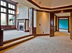 Love the step up into the sitting area with the fireplace! Master Bedroom