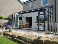 A Conservatory Transformation Dark grey lean-to conservatory including Pilaster posts, bi-folding doors and high performance glass – Refurbish My Conservatory Lean To Conservatory, Conservatory Extension, Conservatory Kitchen, Conservatory Ideas, Conservatory Playroom, House Extension Design, Glass Extension, House Design, Extension Ideas