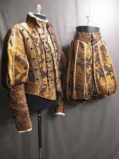 Good Bob clothes! Tudor Doublet and paned slops  [16th Century- Northern Renaissance style of satin breeches. Called open breeches because they are wide and full throughout. Matched with a Doublet of the the same century. You can tell this because of the high collared neckline.]