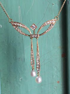 Vintage 14K pearl and diamond bow necklace by VictoriaVVintage on Etsy