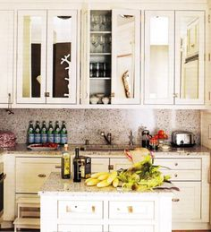 mirrored kitchen cabinet doors -i wonder if i can fix mirrors to my plain white cabinets later on?