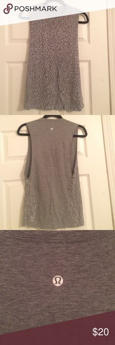 lululemon gray patterned muscle tank, sz 4 Grey, stretchy material. Crew neck, low cut on sides to show off your sports bra. Very stretchy. Size 4 lululemon athletica Tops Muscle Tees