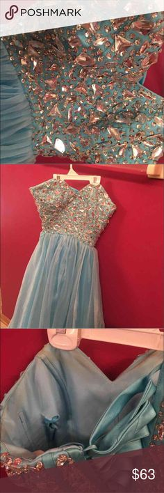 Blue prom dress Sherri hill inspired and is in perfect condition except for the inside there's some spray tan stains and holes due to trying to add padding, has an adjustable corset so it can be tightened or loosened to fit many sizes Dresses Prom