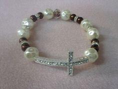 Pearl and brown sideways cross