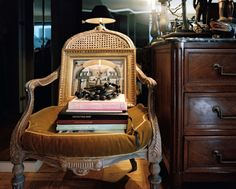 November 2012 Issue Photo - An antique chair topped with books beside a wooden chest