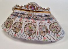 France 1940 hand beaded with Limoges porcelain on fabulous frame. A really beautiful bag. ThePurseMuseum.com