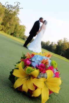 I love that the flowers are in focus and the bride and groom aren't