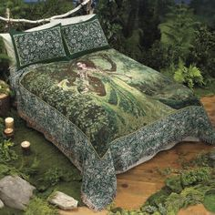 This is the bedspread I'm getting for our forest bedroom. Love the dragon with the woman... I'm making pillows though, the pillow cases are 25 dollars each! Bedspread is $70