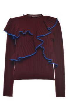 Rendered in a ribbed wool knit, this long sleeve **MSGM** sweater features a crewneck and ruffled details with contrasting trim across the bodice.