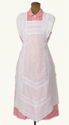 APRIL CORNELL PARLOUR MAID APRON - A pristine cotton pinafore with intricate lace-insertion detail is resurrected from a 19th c. domestic servant cover-up.