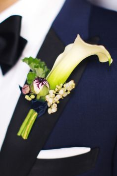 Groom's boutonniere of calla liles, ranunculus buds, andromeda, and germanium; Lauren & Jon's wedding at Alder Manor // Photo: Jonathan Young