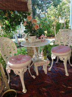 White Iron table with sweetheart chairs