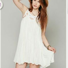 """Ivory, flowy sleeveless tunic dress and gauzy, crinkly crepe. Features striking cutouts around the neckline embellished with subtle embroidery that compliments vertical vine pattern on dress, model is 5'-11"""" %100 cotton %100 Rayon ,full slip. Tag is cut to prevent store returns ,retails for $349 this is a new item never worn"""