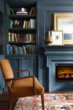 Warm and Cozy Living Room: 10 Ideas. Warm and Cozy Blue Living Room with Fireplace. Lately I've had a craving! Not for chocolate, but for a warm and cozy living room that leaves you feeling like you've just been given a big old hug. Blue Rooms, Blue Walls, Blue And Orange Living Room, Dark Walls, Living Room Decor, Living Spaces, Dining Room, Decor Room, Wall Decor