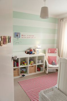 mint green stripes on this baby nursery wall give a modern and clean look