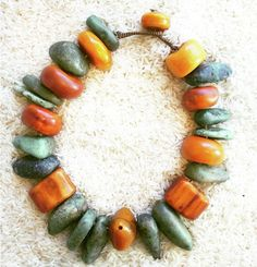 Twiga Gallery Designs   'Righteous Breath' Necklace. Antique copal Amber, Moroccan Amber and Ancient Amazonite and bone beads.   {Price not published, please contact seller}