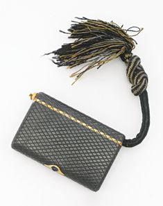 A FABERGÉGOLD-MOUNTED GUNMETAL CIGARETTE CASE, CIRCA 1900. rounded rectangular, engraved with a diaper pattern and with gold band, with hinged vesta compartment and black and gold silk tinder cord, gold-mounted cabochon sapphire thumbpiece, the interior engraved in Cyrillic 5 April 1892 and Listen...never ...with anybody , struck Fabergé in Cyrillic on flange, contained in fitted wood case of retailer A la Vieille Russie