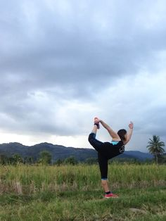 Standing Bow Pose. I love my backyard! » Yoga Pose Weekly