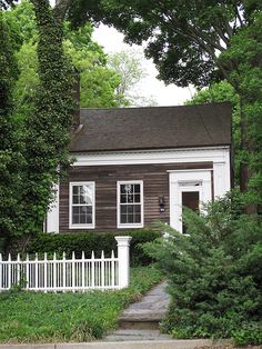 little shingled cottage with white trim