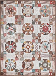 "Vintage-inspired: King George III Quilt. Designed by Sue Ambrose, with inspiration from a photo of a small section of a quilt called 'King George reviewing the volunteers'. Twelve 14 1/2"" blocks with pieced lattice and border, some blocks feature applique. Pattern at Somerset Patchwork and Quilting (Australia)"