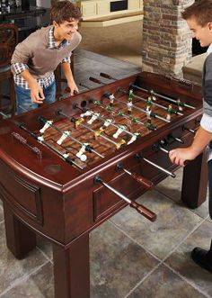 Get your game on with our Classic Foosball Table. This fashionably designed game table complements any decor.