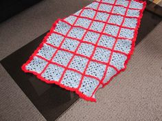 Blue granny square with red border crochet baby blanket or pram rug available at www.woollygoods.com