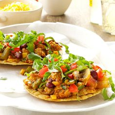 Tangy Turkey Tostadas Recipe -I'm a health fitness specialist and personal trainer, so I know how important it is to make smart food choices to fuel my day. These fast and filling tostadas are packed with lean protein, fiber and a good dose of veggies. Have them any night of the week. —Julie Huntington, Memphis, Tennessee