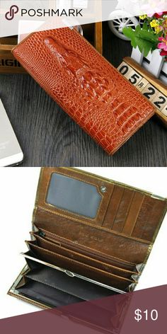 CLASSY ALLIGATOR EMBOSSED LEATHER WALLET  $ 7.00 SALE - Was $34.95 Now $10.00  Classy Alligator Embossed Leather  Long Bi-fold Design  8 Credit Card Slots  1 Clear ID Window  3 Full-Length Bills Compartments   Coins Compartment w/ Clutch Closure  2 Inner Multipurpose Insertion Slots (One w/ Zip Opening)  1 Outside Multipurpose Insertion Slot  Snap Closure  Pewter Metal Hardware  Imported   Material: Genuine Leather   Dimensions: L7.25 in x H3.5 in x D1 in  Net Weight: 8 Oz / 0.5 lb  Product…