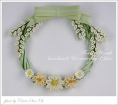 Claire's flower wreath. I've always liked her quillwork. Very elegant.