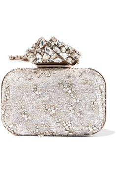 Jimmy Choo's 'Cloud' clutch is exquisitely embellished with crystals, beads and metallic embroidery on wispy organza. Crafted in Italy and lined with dove-gray leather, it's finished with a sculptural knot-shaped clasp inspired by camellias. It will fit your lipstick, cards and cell phone.