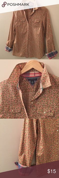 Floral Tommy Shirt Tan button down with pink flowers by Tommy Hilfiger. The details are what makes this shirt so versatile. You can wear the  sleeves up or down. Plaid inside the collar as well. Looks cute with denim and cowboy boots. Tommy Hilfiger Tops Button Down Shirts