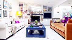 Home Tour: Inside a Colorfully Eclectic Family Home//orange sofa, mirrored fireplace, Missoni throw, blue coffee table