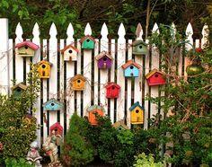 bird houses on fence