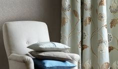 James Hare - Oriel Silks Fabric Collection - Pale blue and brown floral curtains beside a white padded armchair with plain cobalt blue, baby blue and grey cushions Silk Wallpaper, Renaissance Architecture, Floral Curtains, Grey Cushions, Roman Blinds, Brown Floral, Silk Fabric, Hare, Bed Pillows