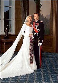 Norwegian Crown Prince Haakon and Princess Mette-Marit on their wedding day in 2001. Dress by Ove Harder Finseth.