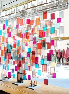 38. Create a page that has a background inspired by this window display at Anthropology  think rectangles, squares and lots of bright color.   1 pt