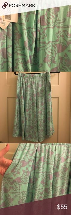 Lularoe Madison Skirt This skirt is super fun and comfortable. The fabric is 96% polyester 4% spandex super light weight and airy, perfect for summer! And who doesn't love a skirt with pockets?! The tags are still attached, never worn tried on a couple times. I wasn't comfortable with the fit on my body but wanted to love this skirt so bad! It is a mint green and lavender purple with German Shepherd dogs on it. So cute! LuLaRoe Skirts A-Line or Full