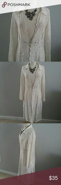 LOVELY OFF WHITE LACE DUSTER W SCALLOPED NECK LINE THIS ELEGANT IVORY LACE DUSTER IS SO FEMININE AND ROMANTIC. WEAR WITH JEANS, DRESSES, OR BOHO PANTS TO CHANGE UP YOUR LOOK. HOOK AND LOOK CLOSURE AT WAIST. THERE IS NO SIZE LABEL BUT MEASURES 17.5 INCHES FROM ONE ARM PIT TO THE OTHER. FROM SHOULDER TO HEM IS 41 INCHES. A REALLY FANTASTIC PIECE TO HAVE IN YOUR WARDROBE. Jackets & Coats
