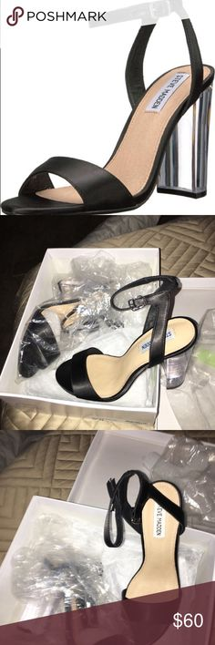 Steve Madden Charity Slide etails Elegance meets contemporary design with the Steve Madden® Charity sandal! Satin upper material. Ankle strap with buckle closure. Open toe. Single strap over vamp. Leather lining. Lightly padded footbed. Clear lucite heel. Man-made outsole. Product measurements were taken using size 7.5, width M. Please note that measurements may vary by size. Measurements: Heel Height: 3 3⁄4 in. Weight: 11 oz. Color: blac Steve Madden Shoes Sandals